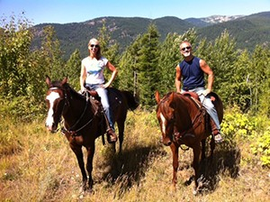 Midlife transition coach Lyn Carpenter finding joy riding horses with her husband Bryan